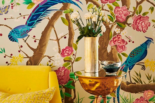Yellow sofa with bird-patterned wallpaper from Be Bold: Interiors for the Brave of Heart by Emily Henson
