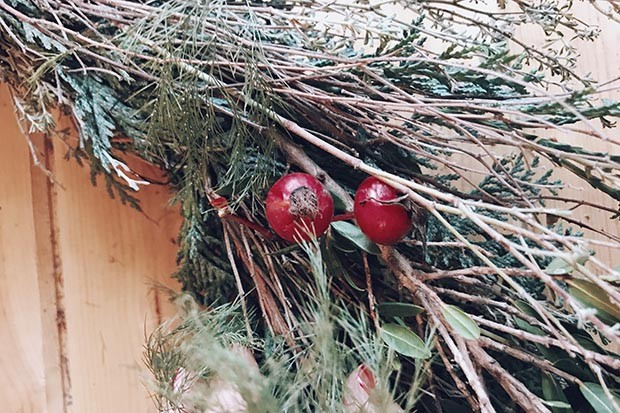 Add berries to the wreath