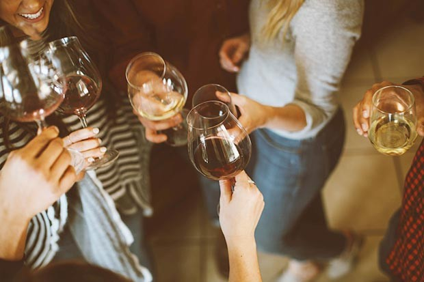 Women drinking wine at a Christmas party