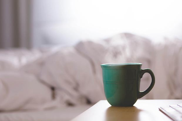 Mug of steaming hot water