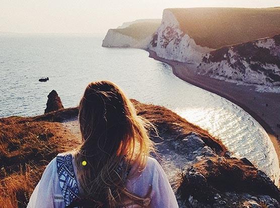 Woman walking by the sea