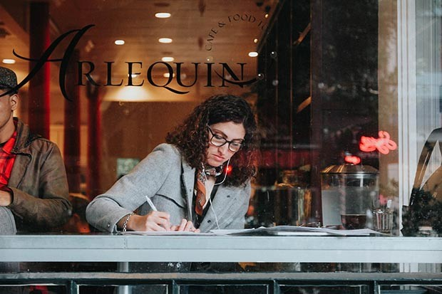 Woman writing in a cafe