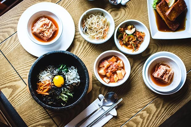 A variety of Korean dishes, including kimchi