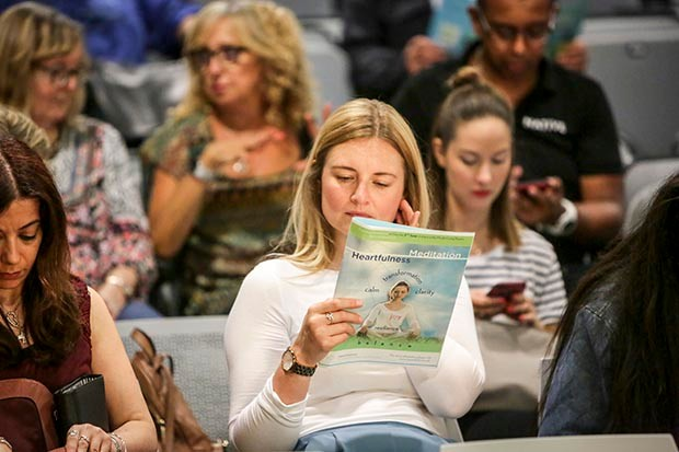 A woman in the audience at the Mindful Living Show