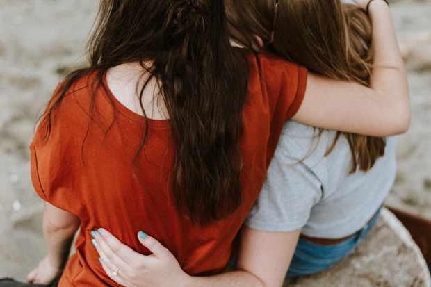 Women embracing