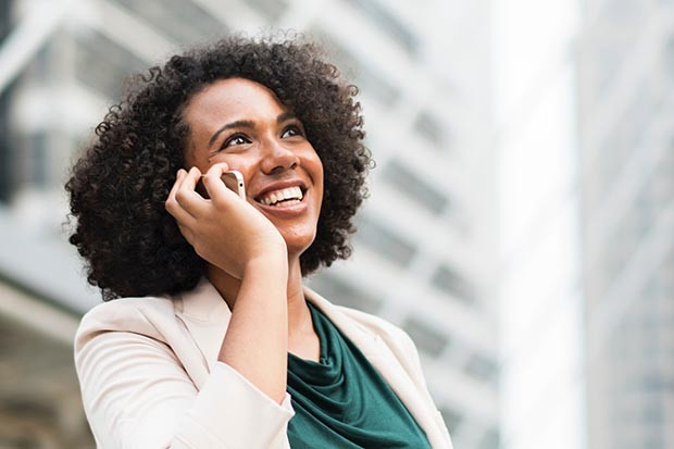 Woman on her mobile phone smiling