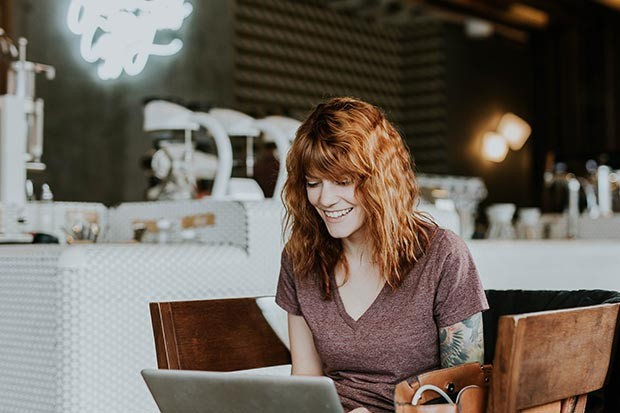 Woman working in a cafe