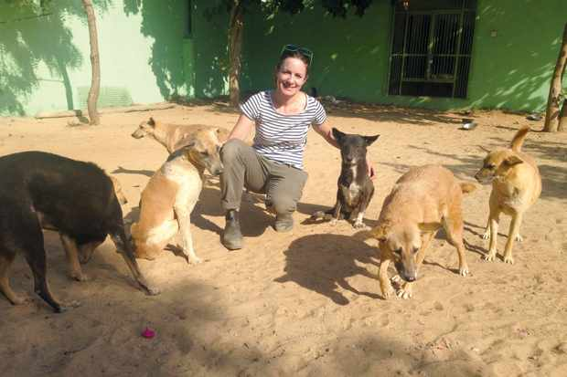 Jo Carnegie with dogs in India