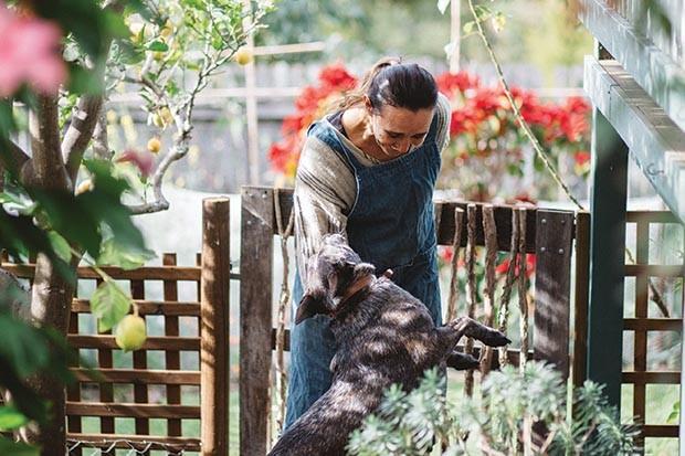 Jody Vassallo playing with her dog