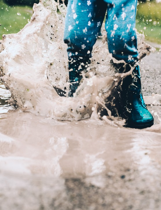 Splashing in puddles wearing wellies, by Rachael Smith / Our Beautiful Adventure
