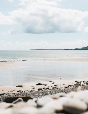 Pristine beach with bright sky, by Rachael Smith / Our Beautiful Adventure