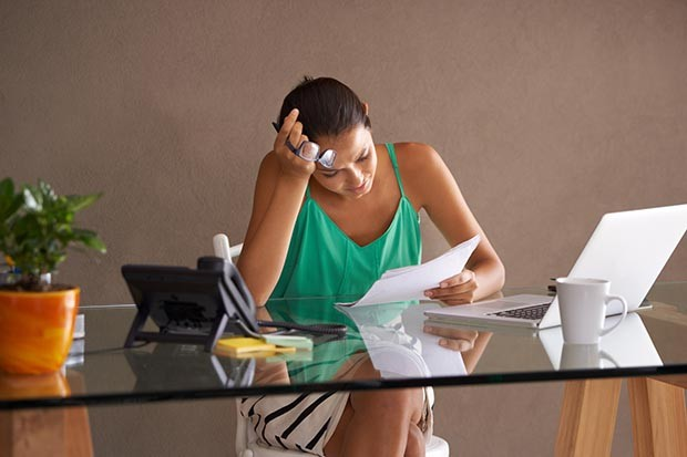 Woman in her office looking stressed