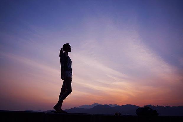 Woman walking at dusk