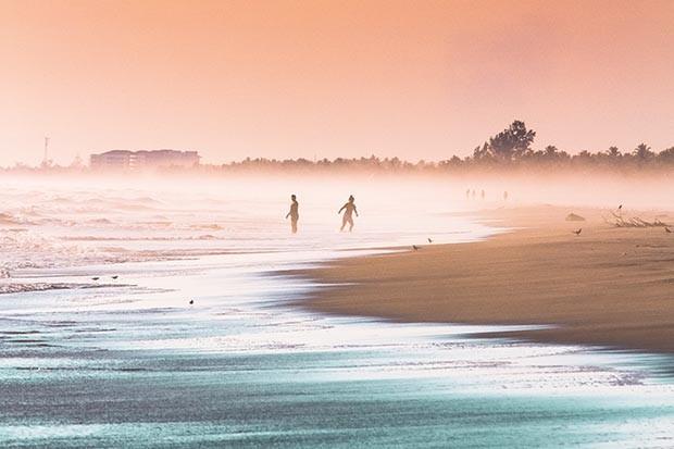 People at the beach in El Salvador