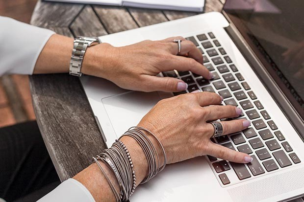 Woman busy typing on a laptop