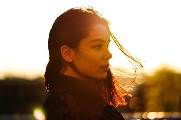 Woman looking thoughtful at sunset