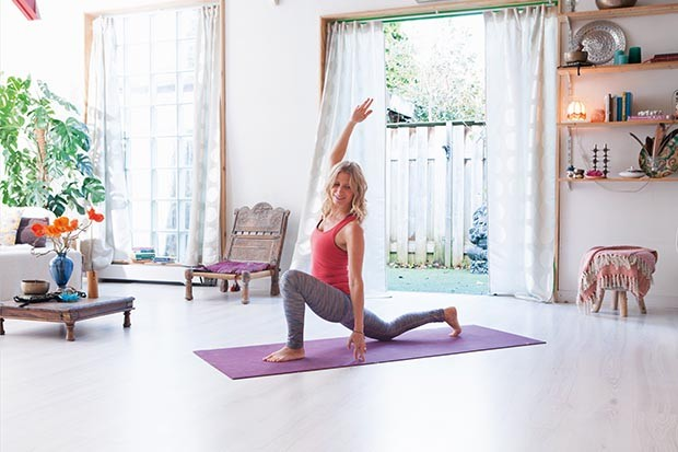 Esther Ekhart practising yoga at home
