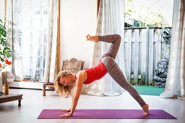 Esther Eckhart practising yoga at home