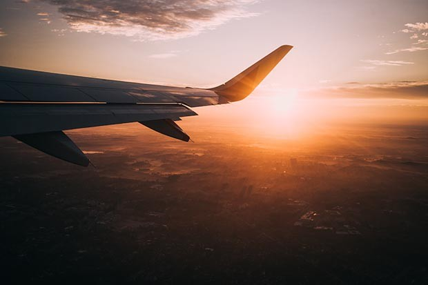 Plane in flight at sunset