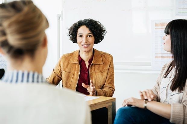 Woman negotiating at work