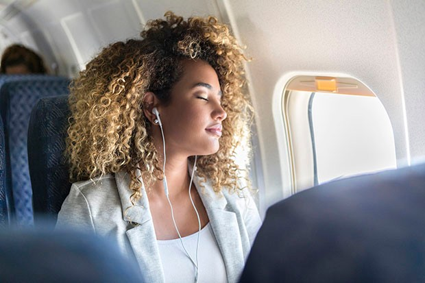 Young woman napping during flight