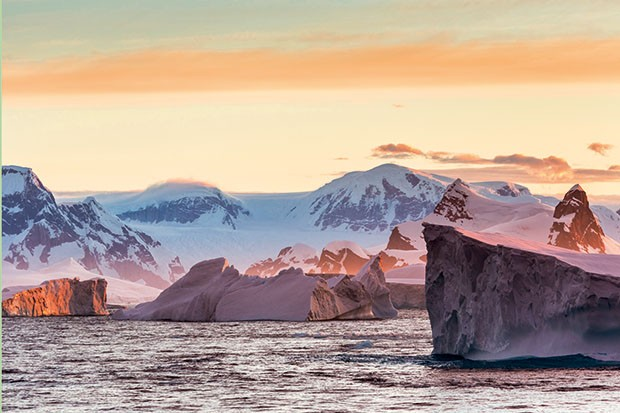 Marine scenic in evening light in the Lamaire channel, Antarctica
