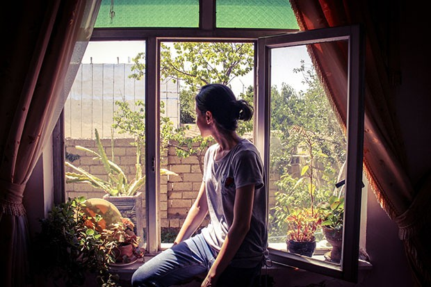 Woman gazing out of a window