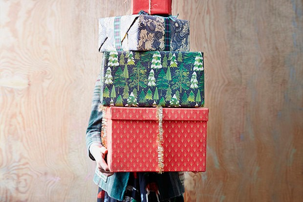 Woman holding a stack of presents