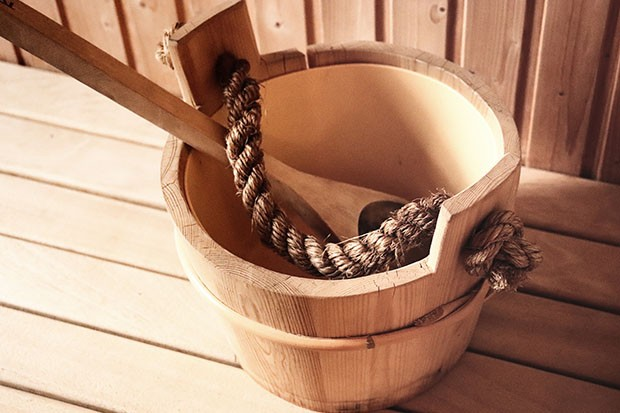 Wooden bucket in a sauna