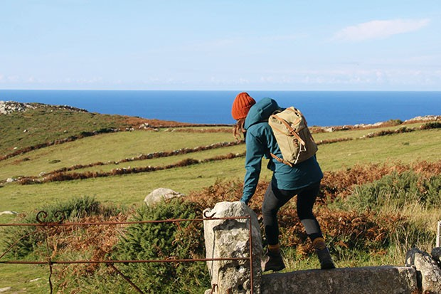 Sian Lewis hiking along the Cornish coastal footpath