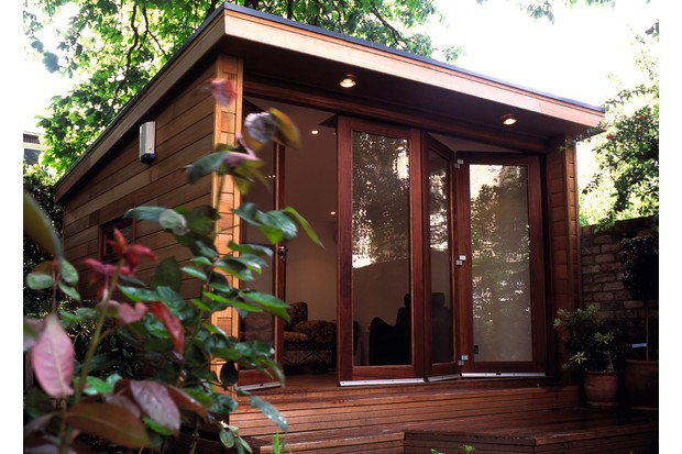 A garden office which is a modern style wooden shed with glass concertina doors