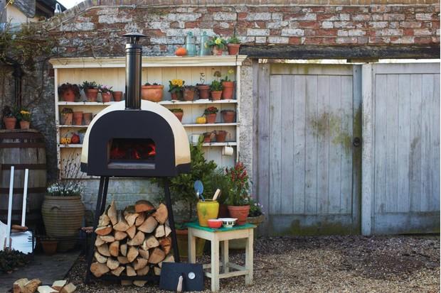 Dom 60 Leggaro oven in outdoor garden by chef Jamie Oliver