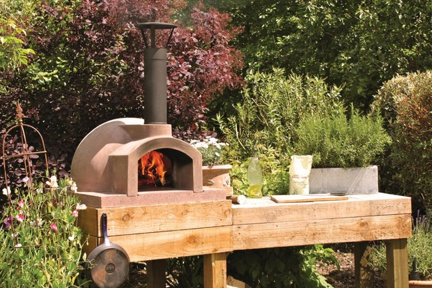 The Primo 60 Go dome shaped outdoor pizza oven by The Stonebake Oven Company in outdoor garden
