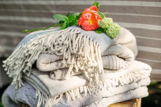 Pile of blankets ready to warm up garden party guests