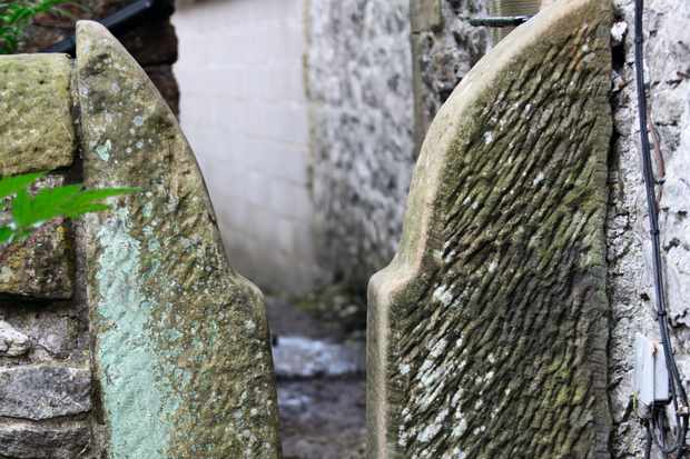 An ancient stone stile forms a small gap