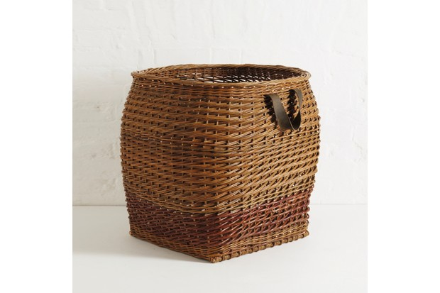 A handwoven square based log basket with two simple looped leather handles by Annemarie O'Sullivan,