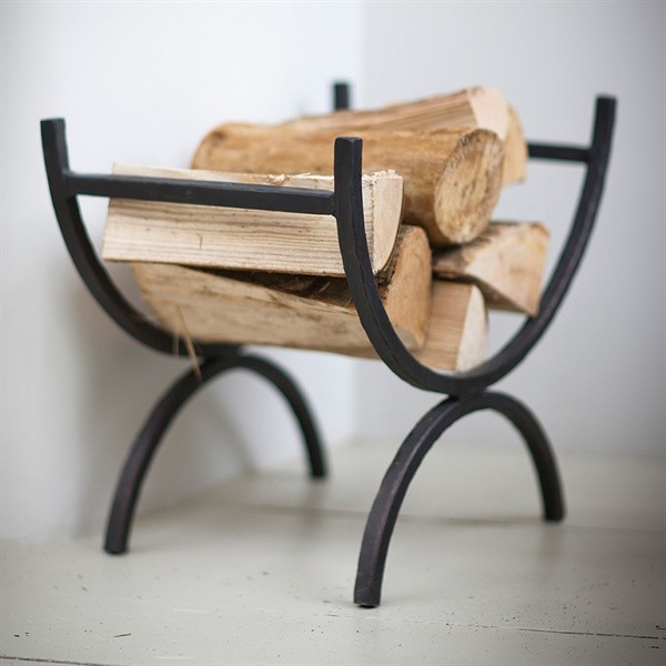 Wrought iron curved log holder with logs by The Cotswold Company