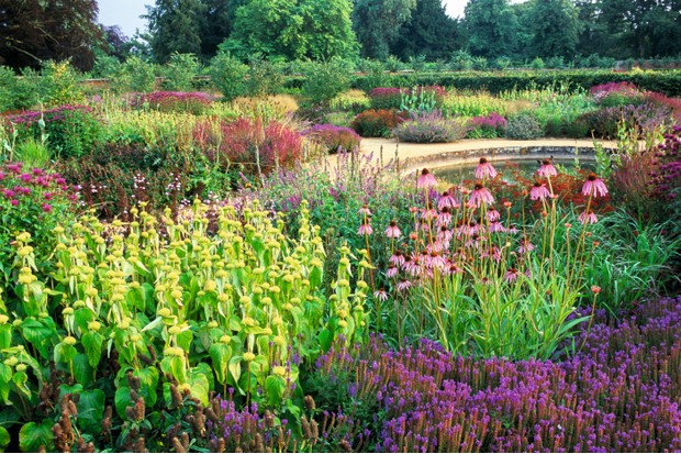 Award winning Scampston Walled Garden, designed by Dutch plantsman Piet Oudolf, featuring modern, perennial low planting alongside traditional areas