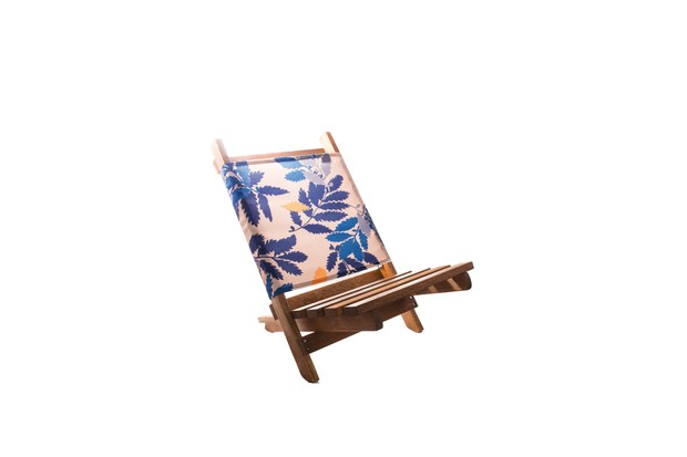 Solid wood beach chair frame and seat with stainless steel fabric fastenings and blue patterned fabric rest back.