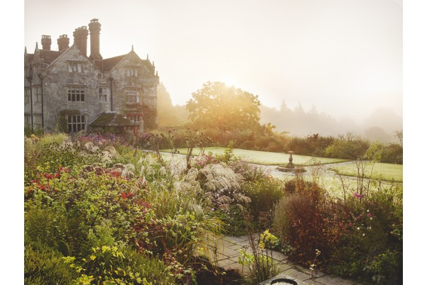 Sunrise over one of the herbaceous borders at Gravetye Manor in East Sussex
