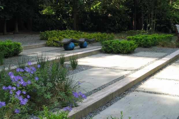 Limestone steps are a solution to coping with slopes. Wide steps create an elegant descent down a sloping garden