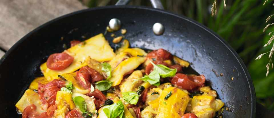 A stir fry dish of yellow courgette and tomatoes