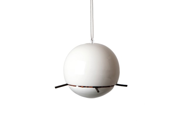 A ball-shaped bird feeder that allows small birds to feed but bigger birds can't eat from it