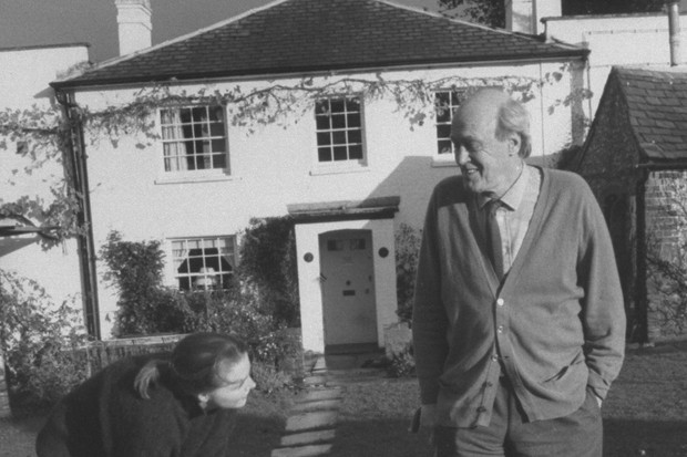 Writer Roald Dahl and daughter Ophelia outside his house with their Jack Russell terrier, Chopper.