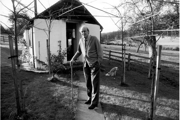 Roald Dahl standing outside the shed where he writes Great Missenden
