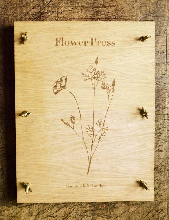 An oak veneer flower press