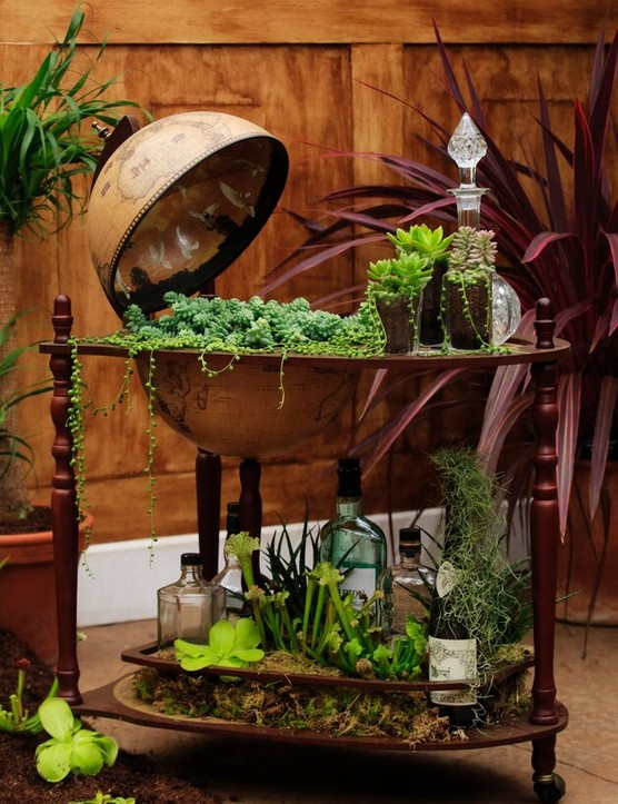 A planted globe drinks cabinet and decanters