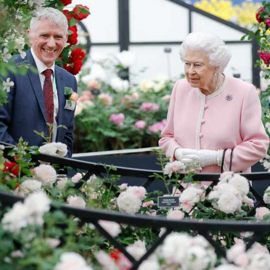 2018: Queen Elizabeth speaks with Ian Limmer on the Peter Beales Roases exhibition as she attends the RHS Chelsea Flower Show