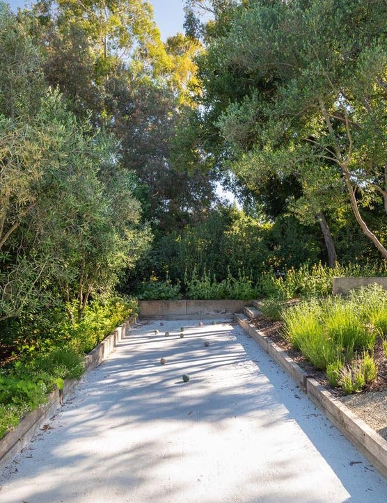 The dry 'Californian' zone, with its bocce court at the top of the garden