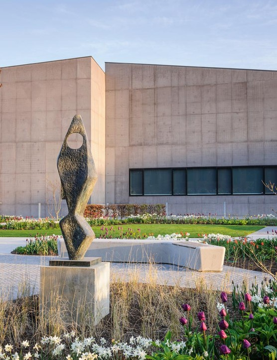 In spring, the sculpture Ascending Form (Gloria), 1958 by Barbara Hepworth is surrounded by a pool of Pennisetum 'Fairy Tails', brightened by the whites of 'Thalia' and 'Toto' daffodils and purple Tulipa 'Negrita'.
